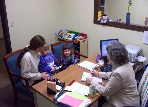 Marie with family | Family Services